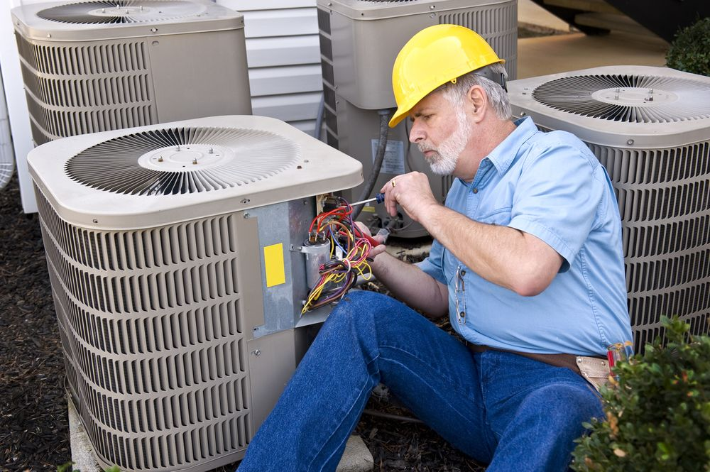 repair tech works on outdoor ac unit